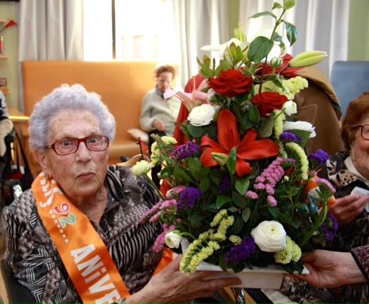 Maria amb el seu ram de flors